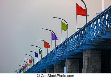 Colorful flags on historic Prakasam Barrage at Vijayawada, India