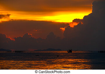 colorful flame cloud sunset on sea and ray colorful sky