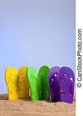 Colorful Flip-Flop Sandles on a Sandy Beach