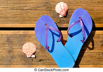 Colorful flip flops on wooden background