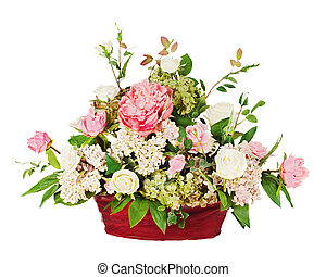 Colorful floral bouquet from roses and cloves arrangement centerpiece in vase isolated on white background