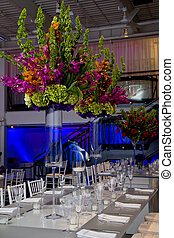 Colorful flower arrangement and table