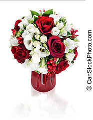 Colorful flower bouquet arrangement centerpiece in red vase isolated on white background.