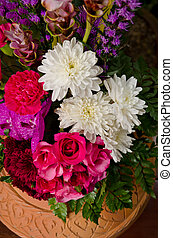 Colorful flower bouquet arrangement in pot.