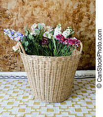 colorful flowers in a basket