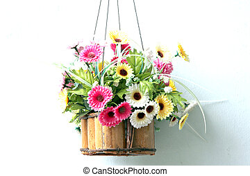 Colorful flowers in a wooden basket.