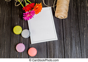 colorful flowers with French Macarons on wooden