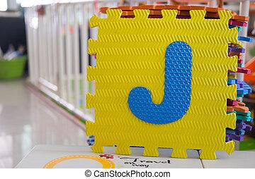 Colorful foam puzzle letters, alphabet J