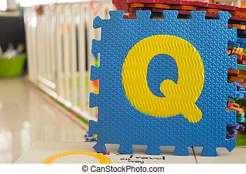 Colorful foam puzzle letters, alphabet Q