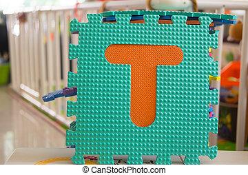 Colorful foam puzzle letters, alphabet T