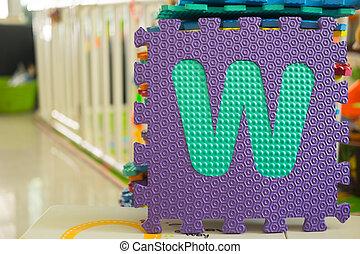 Colorful foam puzzle letters, alphabet W