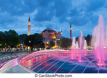 hagia sofia mosque in istanbul - colorful fountain in front ...