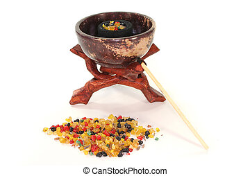 colorful frankincense with incense censer on a white background