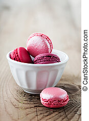 Colorful French macaroons on a rustic wooden background, selective focus