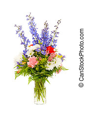 Colorful fresh flower arrangement centerpiece with purple iris, rose, carnation, daisy and delphinium isolated on white background