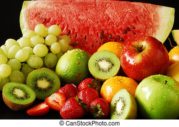 Colorful fresh group of fruits. Black background. Look at my...