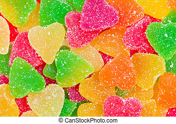 Colorful fruit candy in sugar in the form of hearts