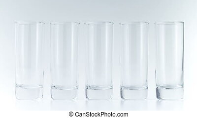Colorful fruit juices fill the glasses on white background....