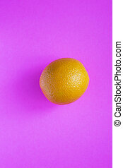 Colorful fruit pattern of fresh orange on pink background. From top view.
