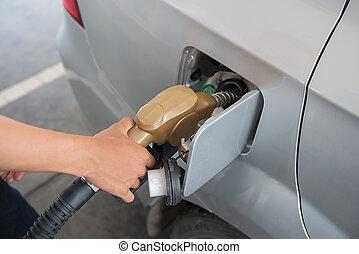 Colorful fuel oil gasoline dispenser at petrol filling...
