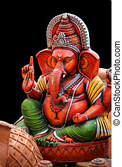 Colorful Ganesh statue isolated on black background
