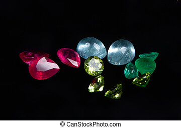 colorful gems isolated on a black background