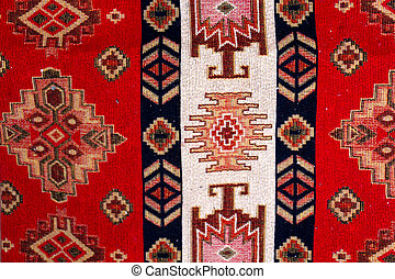 colorful geometric shapes of a carpet, top view