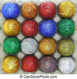 Colorful glitter eggs in carton egg packaging