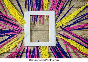 Colorful grass flowers on wooden background