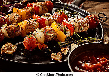 Colorful grilled skewers with meat and vegetables