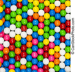 Many round candies arranged in a pattern