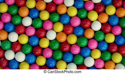 Colorful Gumballs Rotating Overhead Shot - Rows of bubblegum...