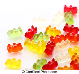 Colorful gummy bear candies over white background