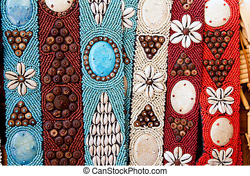 colorful handcrafted belts with sea shells in Balearic...