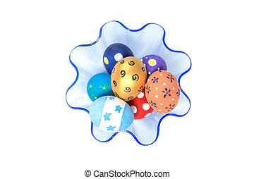Colorful handmade easter eggs in blue tray isolated on a white B