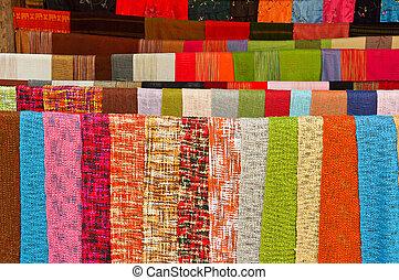 Colorful handmade shawls in loas ma