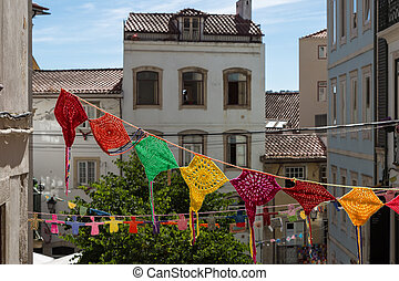 Colorful Hanging Doilies in Public Street in Coimbra, Portugal