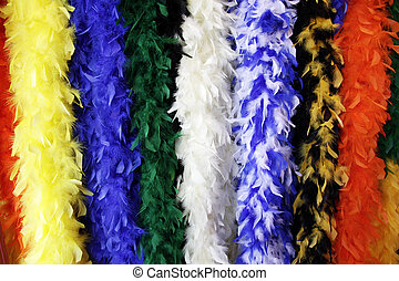 Colorful, hanging feather boas. - Group of hanging colorful...