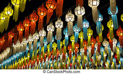 colorful hanging lanterns lighting on night sky in loy krathong festival at northern of thailand