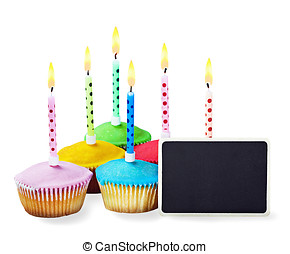 colorful happy birthday cupcakes with candles with a black sign for congratulations