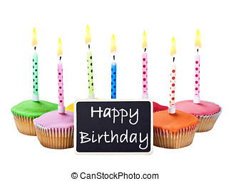 colorful happy birthday cupcakes with candles with...