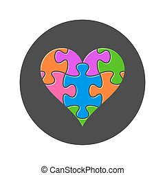 Colorful heart made of puzzle pieces