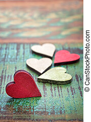 Colorful hearts on a wooden background