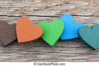 Colorful hearts on wooden background