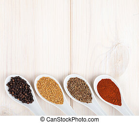Colorful herbs and spices selection. Aromatic ingredients on wood table