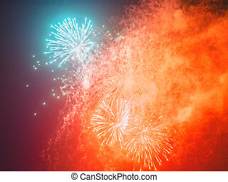 Colorful holiday fireworks in the dark sky
