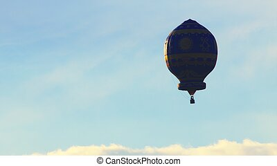Colorful Hot Air Balloon Against A Beautiful Cloudy Blue Sky - Daytime