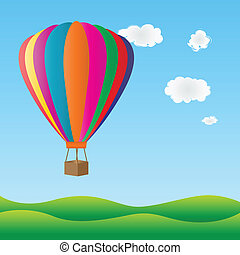 Colorful hot air balloon - Hot air balloon flying over green...