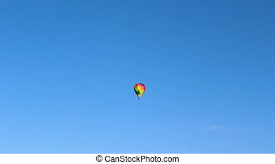Colorful hot air balloon flying on blue sky