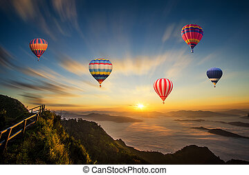 Colorful hot-air balloon flying over the mountain